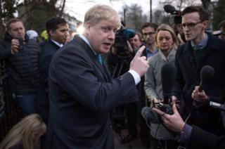 Mayor of London Boris Johnson speaking to the media outside his home in Islington
