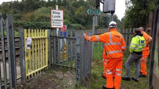 Police and rail staff at the Wallows Lane foot crossing