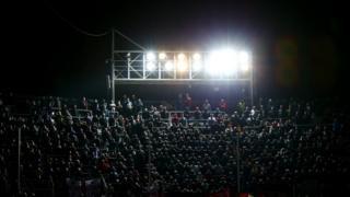 Stadium light shining over audience