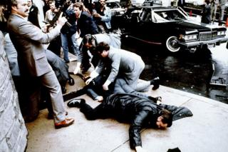 This photo taken by presidential photographer Mike Evens on March 30, 1981 shows police and Secret Service agents reacting during the assassination attempt on then US president Ronald Reagan,