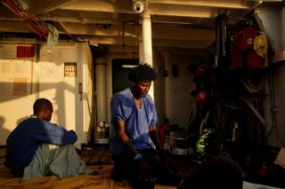 Ahmed, 38, from Sudan, prays on board NGO Proactiva Open Arms rescue boat in central Mediterranean Sea