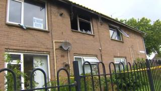Exterior view of fire-damage first floor flat