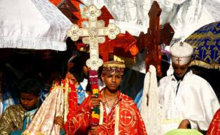 A deacon carrying a cross during the annual Timkat epiphany celebration in Gondar, Ethiopia - Wednesday 18 January 2017