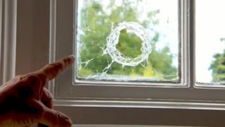 Ball bearing fired at window