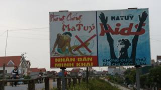 Billboards warning about drug addiction, beside a road outside Hanoi. 18 May 2016.