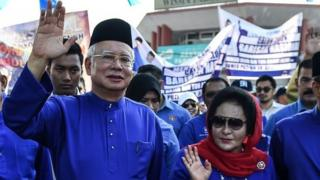 Mantan PM Najib Razak dan istrinya