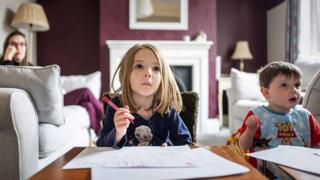 Portrait of the photographer's children at home, home-schooling