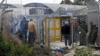 Palestinian workers wait to cross into Israeli settlement area at the Mitar checkpoint, south of the West Bank city of Hebron, 19 January 2016
