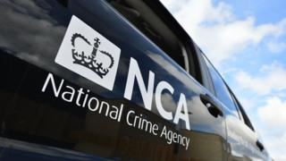 A van with an National Crime Agency logo