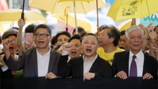 Activists Chan Kin-man, Benny Tai, and Chu Yiu-ming outside court in Hong Kong ahead of their sentencing, April 2019