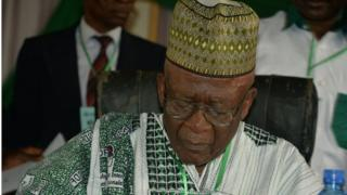 Cameroon's Social Democratic Front (SDF) leader Ni John Fru Ndi looks at notes as he addresses his party congress in Bamenda on February 22, 2018