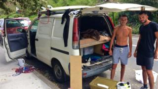 French tourists Anthony Fenech and Pierre Stoar with their van, which they sleep in