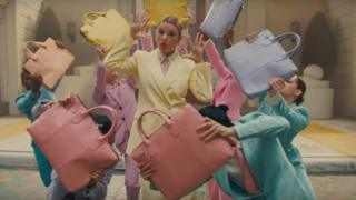 Taylor surrounded by handbags in Me! video