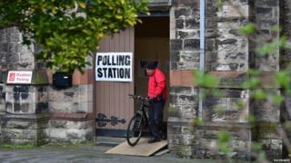 Voter on bike