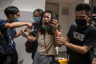 in_pictures A woman reacts after she was hit with pepper spray