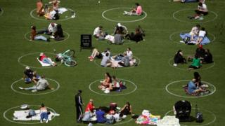 People in Domino Park are seen in circles painted as guidelines for social distancing during the outbreak of the coronavirus disease (COVID-19) in Brooklyn, New York City, U.S., May 24, 2020