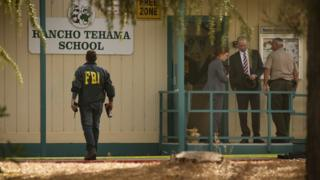 FBI agents are seen outside the Rancho Tehama Elementary School after a shooting in Rancho Tehama, California.