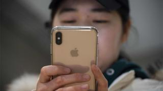 Chinese person and iPhone