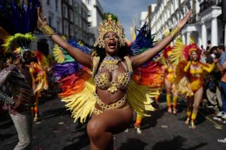 Carnival performers participate in the parade on the main day of the Notting Hill Carnival in west London on 28 August 2017.