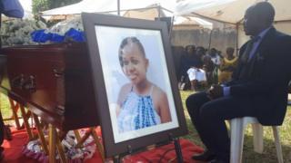 Nikita Pearl Waligwa's coffin and photograph