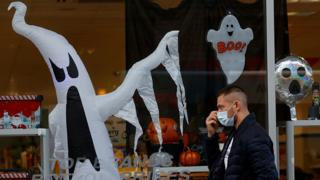 Man in mask walking past shop in Liverpool with Halloween ghost in the window  Covid-19 in the UK: How many coronavirus cases are there in your area? | Daily's Flash  114801016 liverpool976rtrs  Covid-19 in the UK: How many coronavirus cases are there in your area? | Daily's Flash  114801016 liverpool976rtrs