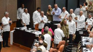 Cuban President Miguel Diaz Canel applauds former President Raul Castro at the Cuban Parliament at the Convention Palace in Havana, on 2 June 2018