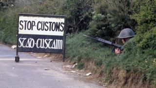 An Irish soldier guards a customs post on the southern side of the border at Swanlinbar, County Cavan, in the mid 1970s