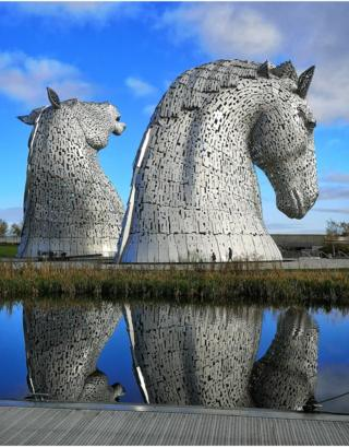 The Kelpies and their reflection in the canal water below.