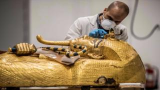 in_pictures An Egyptian archeologist performs restorations on the golden sarcophagus of the ancient Egyptian Pharaoh Tutankhamun