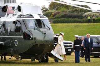 Mr and Mrs Trump step out of a helicopter