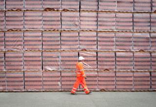 Worker in front of bricks stacks