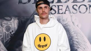 Justin Bieber poses in his own branded clothing range at the premiere for the documentary television series Justin Bieber: Seasons