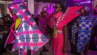 Models wearing futuristic designs by Liputa Swagga during Dakar Fashion Week in Dakar, Senegal
