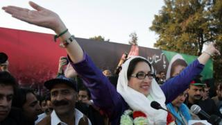 Pakistani former premier Benazir Bhutto waves to her supporters as she arrived for an election campaign rally in Rawalpindi 27 December 2007.