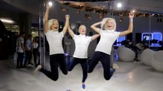 Estonia's Olympic team female marathon runners triplets (L-R) Leila, Lily and Liina Luik play with a tech installation after a training session in Tartu, Estonia, May 26, 2016