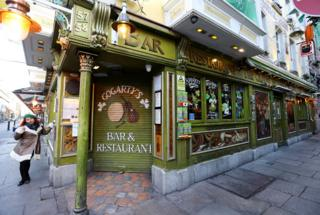 Pub doors are locked in the Temple Bar area of Dublin. 15 March 2020