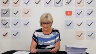A Norwegian woman reads out terms and conditions from a smartphone app