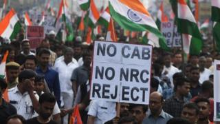 """Supporters and activists of Trinamool Congress (TMC) participate in a mass rally attended by Chief minister of West Bengal state and leader of the Trinamool Congress (TMC) Mamata Banerjee (unseen), to protest against the Indian government""""s Citizenship Amendment Act (CAA) in Kolkata on December 17, 2019. -"""