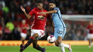 Marcus Rashford of Manchester United (L) and Gael Clichy of Manchester City (R) battle for possession of the ball