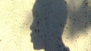 Shadow photo of young woman