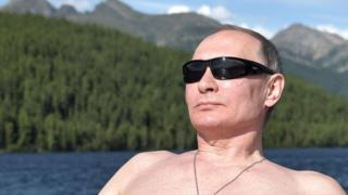 A topless, sunglass-wearing picture of Russian President Vladimir Putin on holiday in Siberia in August