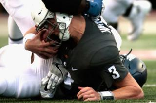 Hilinski is tackled during a game in September 2017