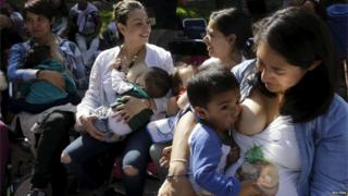 Women breastfeed babies during an event at a park in Mexico City. (01/08/2015)