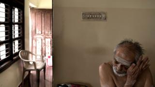 Mr Satyanarayan wipes his tears while speaking about life in the care home