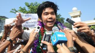 File photo: Peace activist Yan Naing Tun talks to the media after his release in front of Insein prison in Yangon, 31 December 2013