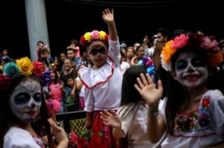 Young girls dressed as Catrina take part in a parade ahead of Day of the Dead in Monterrey, Mexico October 27, 2019