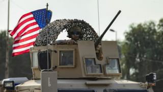 A US soldier in an armoured vehicle in northern Syria