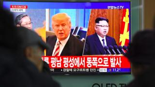 Trump and Kim on a television in Seoul