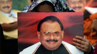 "Supporters of Pakistan""s Muttahida Qaumi Movement (MQM) party hold photographs of party leader Altaf Hussain as they stage a sit-in calling for his release in Karachi on June 3, 2014."