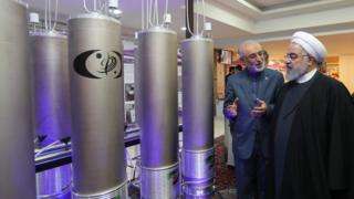 Iranian President Hassan Rouhani is shown nuclear technology by Ali Akbar Salehi, head of Atomic Energy Organization of Iran (9 April 2019)